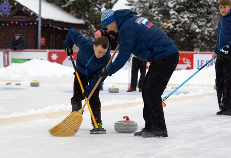 calibrate: MOSCOW - JANUARY 17, 2016: Curling players A. Kirikov (L) and S. Morozov (R) in action during Russian Curling Champions Tour Moscow Classic 2016 on January 17, in Moscow, Russia, 2016
