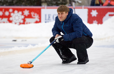 MOSCOW - JANUARY 17, 2016: Curling player D. Abanin in action during Russian Curling Champions Tour Moscow Classic 2016 on January 17, in Moscow, Russia, 2016 Editorial