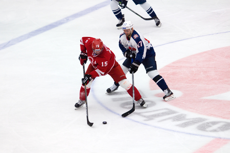 f 15: PODOLSK - NOVEMBER 21, 2015: R. Horak (15) versus F. Shutz (17) during hockey game Vityaz vs Torpedo on Russia KHL championship in Vutyaz ice arena, Podolsk, Russia. Torpedo won 4:3