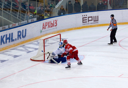 MOSCOW - JANUARY 15: G. Klimenko (83) score during hockey game Spartak vs Admiral on Russian KHL premier hockey league Championship on January 15, 2016, in Moscow, Russia. Spartak won 5:4 Editorial