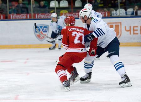 spartak: MOSCOW - JANUARY 15: V. Leshchenko (27) versus D. Kosmachev (12) during hockey game Spartak vs Admiral on Russian KHL premier hockey league Championship on January 15, 2016, in Moscow, Russia. Spartak won 5:4 Editorial