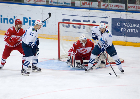 15 18: MOSCOW - JANUARY 15: A. Ugarov (18) attack during hockey game Spartak vs Admiral on Russian KHL premier hockey league Championship on January 15, 2016, in Moscow, Russia. Spartak won 5:4