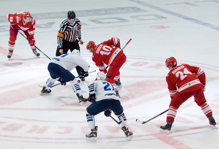 MOSCOW - JANUARY 15: E. Bodrov (10) and M. Fisenko on faceoff during hockey game Spartak vs Admiral on Russian KHL premier hockey league Championship on January 15, 2016, in Moscow, Russia. Spartak won 5:4 Editorial