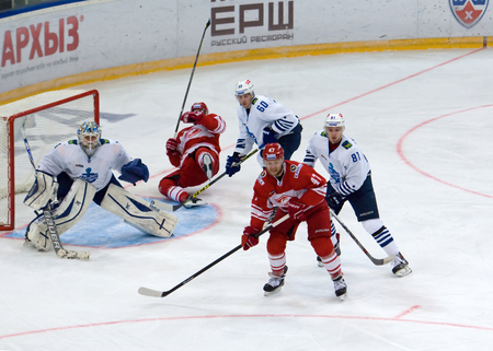 MOSCOW - JANUARY 15: A. Mereskin (25) fall down during hockey game Spartak vs Admiral on Russian KHL premier hockey league Championship on January 15, 2016, in Moscow, Russia. Spartak won 5:4