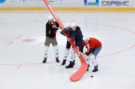 MOSCOW - JANUARY 15: Unidentified people hold giant stick hockey game Spartak vs Admiral on Russian KHL premier hockey league Championship on January 15, 2016, in Moscow, Russia. Spartak won 5:4 Editorial