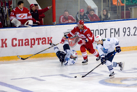 spartak: MOSCOW - JANUARY 15: V. Alexandrov (34) fall down during hockey game Spartak vs Admiral on Russian KHL premier hockey league Championship on January 15, 2016, in Moscow, Russia. Spartak won 5:4