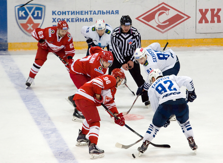 MOSCOW - JANUARY 15: K. Wellman (7) and D. Sayustov (81) during hockey game Spartak vs Admiral on Russian KHL premier hockey league Championship on January 15, 2016, in Moscow, Russia. Spartak won 5:4