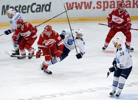 spartak: MOSCOW - JANUARY 15: I. Levitsky (80) and A. Zemchyonok (8) fall down during hockey game Spartak vs Admiral on Russian KHL premier hockey league Championship on January 15, 2016, in Moscow, Russia. Spartak won 5:4 Editorial