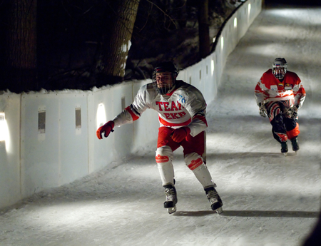 sportsmen: MOSCOW - JANUARY 16: Unidentified sportsmen skate downhill during Ice Cross Downhill World Championship on January 15, 2016, in Moscow, Russia