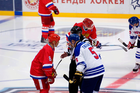 legends: MOSCOW - JANUARY 29, 2016: I. Larionov (8) and E. Tikkanen (5) talk on hockey game Finland vs Russia on League of World legends of Ice hockey championship in VTB ice arena, Russia. Russia won 6:2
