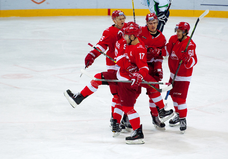 MOSCOW, RUSSIA - SEPTEMBER 27, 2016: A. Voronin (17) and other Spartak team players rejoice of score on hockey game Spartak vs Ugra on Russia KHL championship on September 27, 2016, in Moscow, Russia. Ugra won 3:2