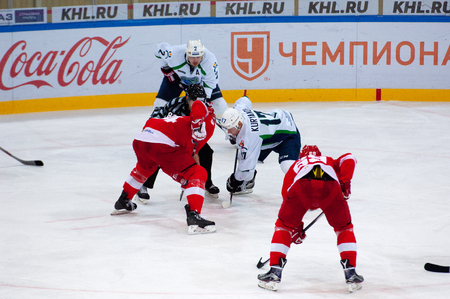 spartak: MOSCOW, RUSSIA - SEPTEMBER 27, 2016: M. Hogstrom (4) and A. Kuryanov (17) on faceoff on hockey game Spartak vs Ugra on Russia KHL championship on September 27, 2016, in Moscow, Russia. Ugra won 3:2