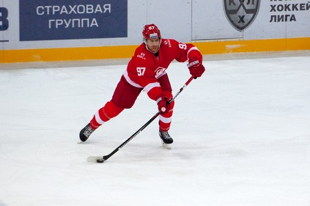 spartak: MOSCOW, RUSSIA - SEPTEMBER 27, 2016: Matt Gilroy (97) dribble on hockey game Spartak vs Ugra on Russia KHL championship on September 27, 2016, in Moscow, Russia. Ugra won 3:2