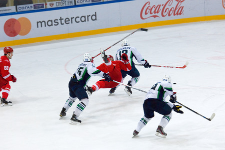 MOSCOW, RUSSIA - SEPTEMBER 27, 2016: Flying A. Vasilyev (10) fall down on hockey game Spartak vs Ugra on Russia KHL championship on September 27, 2016, in Moscow, Russia. Ugra won 3:2 Editorial