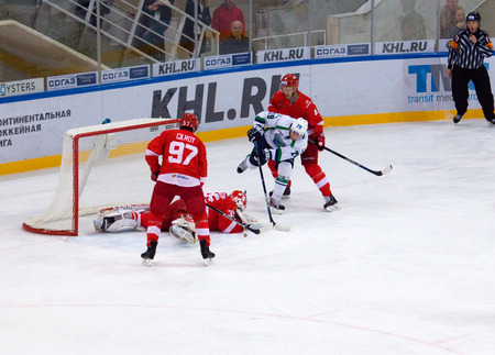 MOSCOW, RUSSIA - SEPTEMBER 27, 2016: Denis Khlystov (29) attack, Matt Gilroy (97) defend on hockey game Spartak vs Ugra on Russia KHL championship on September 27, 2016, in Moscow, Russia. Ugra won 3:2