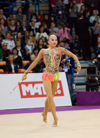 cup of russia: MOSCOW, RUSSIA - FEBRUARY 20, 2016: Sabina Asirbayeva, Kazakhstan, clubs, on Rhythmic gymnastics Alina Cup Grand Prix Moscow - 2016 on February 20, 2016, in Moscow, Russia