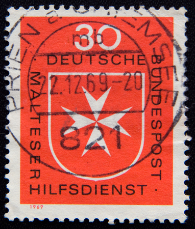 MOSCOW RUSSIA - NOVEMBER 25, 2012: A stamp printed in Germany, shows Maltese cross, circa 1969