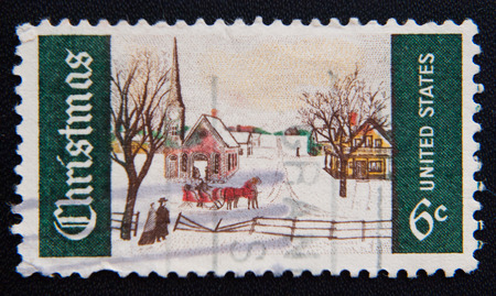 postage: MOSCOW RUSSIA - NOVEMBER 25, 2012: A used postage stamp from the USA depciting a snowy Christmas scene, circa 1969