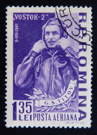 vostok: MOSCOW RUSSIA - NOVEMBER 25, 2012: A stamp printed in Romania shows portrait of soviet cosmonaut Georgy Titov, circa 1961