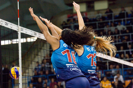 f 16: MOSCOW - DECEMBER 2: F. G. Rodrigez (16) and I. Fetisova (13) defend on a game Dynamo MSK vs Dynamo KZN on Russian National wemen Volleyball tournament on December 2, in Moscow, Russia, 2015 Editorial