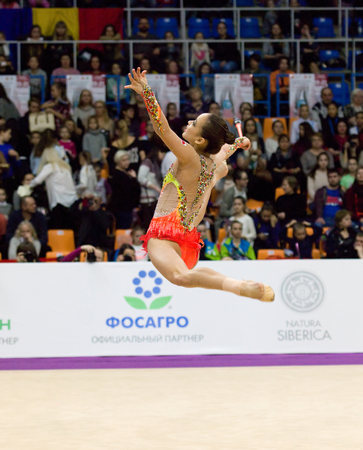 grand son: MOSCOW, RUSSIA - FEBRUARY 20, 2016: Yeon Jae Son, clubs, Korea, on Rhythmic gymnastics Alina Cup Grand Prix Moscow - 2016 on February 20, 2016, in Moscow, Russia