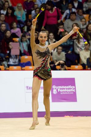 MOSCOW, RUSSIA - FEBRUARY 20, 2016: Karina Kuznetsova, clubs, Russia, on Rhythmic gymnastics Alina Cup Grand Prix Moscow - 2016 on February 20, 2016, in Moscow, Russia