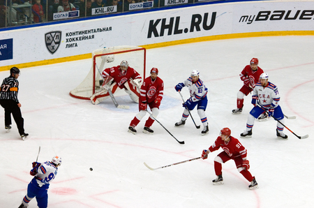 gusev: PODOLSK, RUSSIA - NOVEMBER 30, 2016: Nikita Gusev (97) shoot on hockey game Vityaz vs SKA on Russia KHL championship on November 11, 2016, in Podolsk, Russia. SKA won 4:0