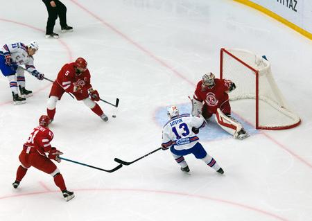 defend: PODOLSK, RUSSIA - NOVEMBER 30, 2016: A. Semenov (5) defend the gate on hockey game Vityaz vs SKA on Russia KHL championship on November 11, 2016, in Podolsk, Russia. SKA won 4:0 Editorial