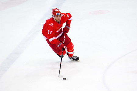 MOSCOW, RUSSIA - SEPTEMBER 27, 2016: Matt Gilroy (97) dribble during hockey game Spartak vs Ugra on Russia KHL championship on September 27, 2016, in Moscow, Russia. Ugra won 3:2