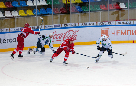 MOSCOW, RUSSIA - SEPTEMBER 27, 2016: L. Radil (69) dribble on hockey game Spartak vs Ugra on Russia KHL championship on September 27, 2016, in Moscow, Russia. Ugra won 3:2 Editorial