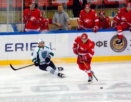 MOSCOW, RUSSIA - SEPTEMBER 27, 2016: P. Varfolomeyev (66) and M. Potapov (15) in action on hockey game Spartak vs Ugra on Russia KHL championship on September 27, 2016, in Moscow, Russia. Ugra won 3:2