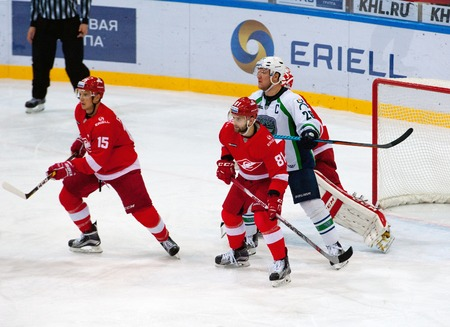 MOSCOW, RUSSIA - SEPTEMBER 27, 2016: Unidentified players fight on hockey game Spartak vs Ugra on Russia KHL championship on September 27, 2016, in Moscow, Russia. Ugra won 3:2 Editorial
