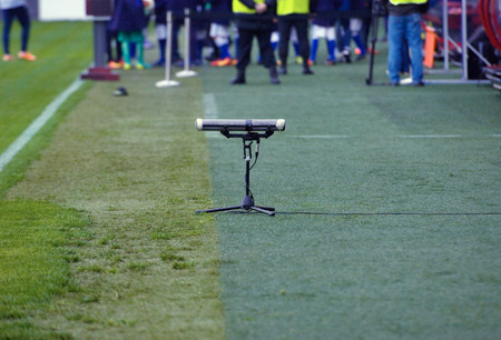 kuban: Microphone on field edge for recording sound of soccer game