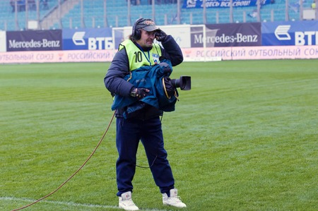 cup of russia: MOSCOW, RUSSIA - OCTOBER 8, 2016: Unidentified reporter with camera on Football Cup of Russia game FC Dynamo Moscow vs FC Kuban Krasnodar (1:0), October 8, 2016