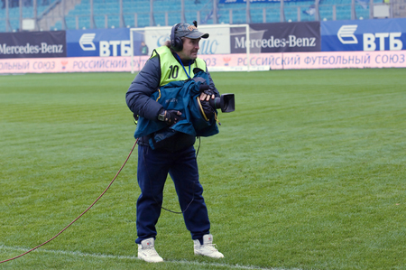 kuban: MOSCOW, RUSSIA - OCTOBER 8, 2016: Unidentified reporter with camera on Football Cup of Russia game FC Dynamo Moscow vs FC Kuban Krasnodar (1:0), October 8, 2016