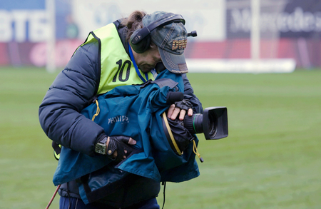 premier: MOSCOW, RUSSIA - OCTOBER 8, 2016: Unidentified reporter with camera on Football Cup of Russia game FC Dynamo Moscow vs FC Kuban Krasnodar (1:0), October 8, 2016