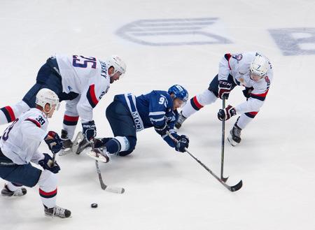 MOSCOW, RUSSIA - OCTOBER 12, 2016: Ilya Shipov (98) fall down hockey game Dynamo Moscow vs Slovan Bratislava on Russia KHL championship. Slovan won 5:3 Editorial