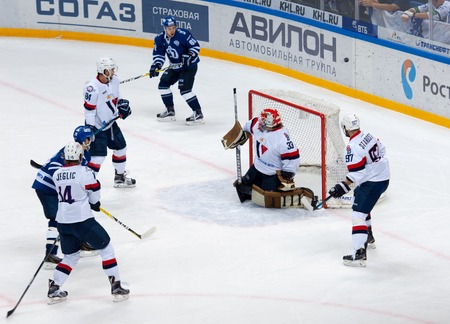 bratislava: MOSCOW, RUSSIA - OCTOBER 12, 2016: Barry Brust (33) save the gate on hockey game Dynamo Moscow vs Slovan Bratislava on Russia KHL championship. Slovan won 5:3