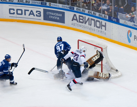 MOSCOW, RUSSIA - OCTOBER 12, 2016: Barry Brust (33) save the gate on hockey game Dynamo Moscow vs Slovan Bratislava on Russia KHL championship. Slovan won 5:3
