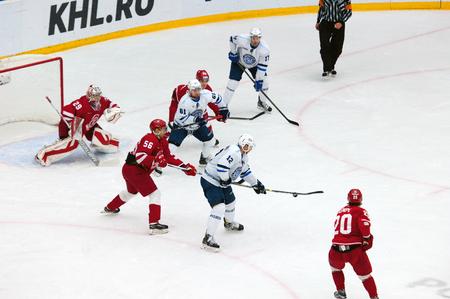 PODOLSK - OCTOBER 30, 2016: S. Gimaev (56) vs R. Klinkhammer (12) on hockey game Vityaz vs Dynamo Minsk on Russia KHL championship on October 30, 2016, in Podolsk, Russia. Vityaz won 9:6