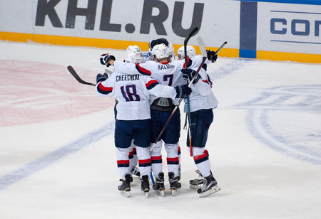 hapy: MOSCOW, RUSSIA - OCTOBER 12, 2016: Unidentified players of Slovan team rejoice of score on hockey game Dynamo Moscow vs Slovan Bratislava on Russia KHL championship. Slovan won 5:3