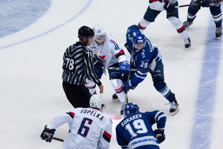 bratislava: MOSCOW, RUSSIA - OCTOBER 12, 2016: A. Kuznetsov (39) and P. Lusnak (41) on faceoff on hockey game Dynamo Moscow vs Slovan Bratislava on Russia KHL championship. Slovan won 5:3