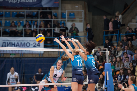 defend: MOSCOW - NOVEMBER 2, 2016: I. Fetisoav (13) and N. Goncharova (8) defend on game Dynamo MSK vs Dynamo KZN on Russian National wemen Volleyball tournament on November 2, in Moscow, Russia, 2016