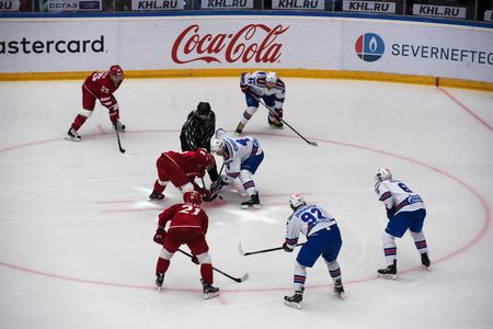 jarno: PODOLSK, RUSSIA - NOVEMBER 11, 2016: Jarno Koskiranta (4) on faceoff on hockey game Vityaz vs SKA on Russia KHL championship on November 11, 2016, in Podolsk, Russia. SKA won 4:0