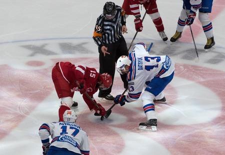 R: PODOLSK, RUSSIA - NOVEMBER 11, 2016: R. Horak (1) vs P. Datsyuk (13) on faceoff on hockey game Vityaz vs SKA on Russia KHL championship on November 11, 2016, in Podolsk, Russia. SKA won 4:0