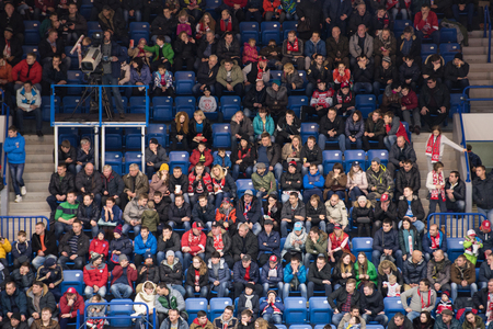 PODOLSK, RUSSIA - NOVEMBER 11, 2016: Fans of Vityaz team on tribune on hockey game Vityaz vs SKA on Russia KHL championship on November 11, 2016, in Podolsk, Russia. SKA won 4:0 Imagens - 68267369