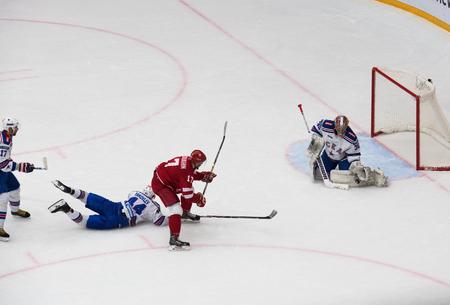 PODOLSK, RUSSIA - NOVEMBER 11, 2016: V. Solodukhin (17) attack on hockey game Vityaz vs SKA on Russia KHL championship on November 11, 2016, in Podolsk, Russia. SKA won 4:0