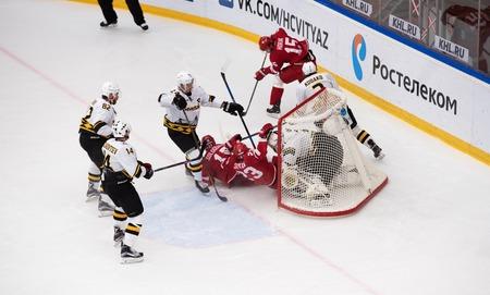 PODOLSK, RUSSIA - NOVEMBER 13, 2016: D. Shitikov (23) and V. Solodukhin (21) fall down on hockey game Vityaz vs Severstal on Russia KHL championship on November 13, 2016, in Podolsk, Russia. Vityaz won 4:0