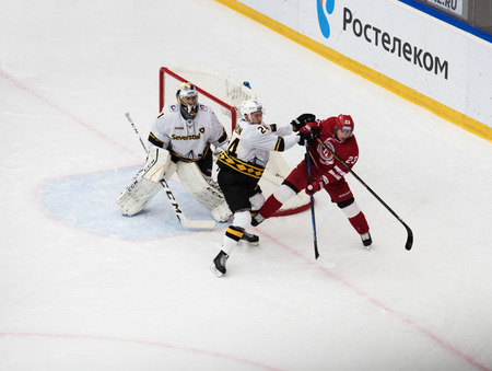 PODOLSK, RUSSIA - NOVEMBER 13, 2016: R. Karlin (24) fault on D. Shitikov (23) on hockey game Vityaz vs Severstal on Russia KHL championship on November 13, 2016, in Podolsk, Russia. Vityaz won 4:0