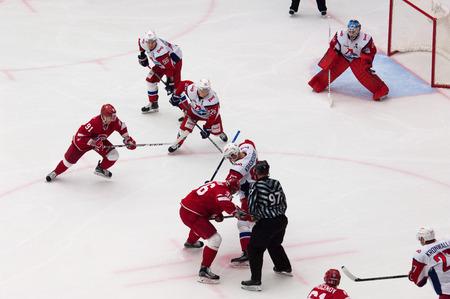 PODOLSK, RUSSIA - NOVEMBER 20, 2016: A. Nikulin (36) and P. Kraskovsky (63) on faceoff on hockey game Vityaz vs Lokomotiv on Russia KHL championship on November 20, 2016, in Podolsk, Russia. Vityaz won 2:1